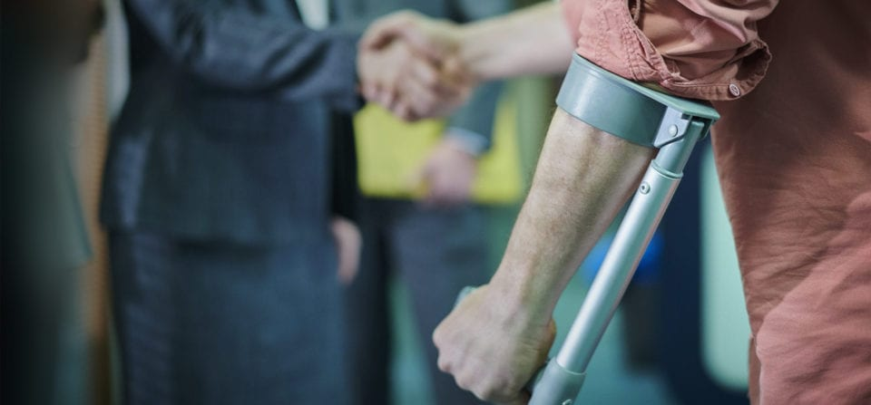 personal injury attorney shaking hands with injured person