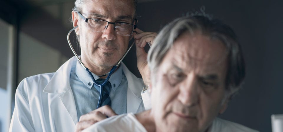 doctor listening to patients lungs asbestos related disease