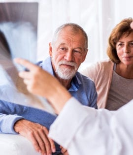 Couple speaking with a doctor